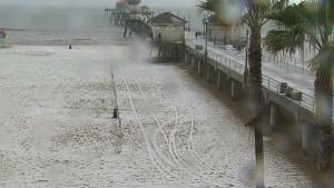 Pea-sized hail covered Huntington Beach Monday morning. (Credit: KTLA)