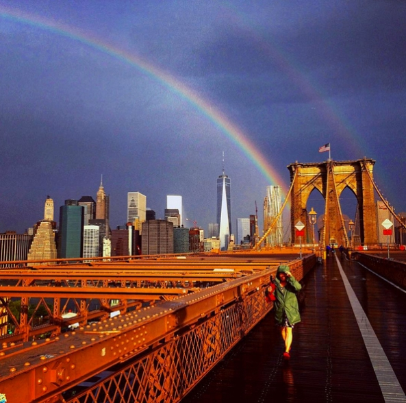 A beautiful rainbow shines bright over the World Trade Center the day before the 14th anniversary of 9/11. Photo captured by Tim Rice (Instagram: @flowkradd).
